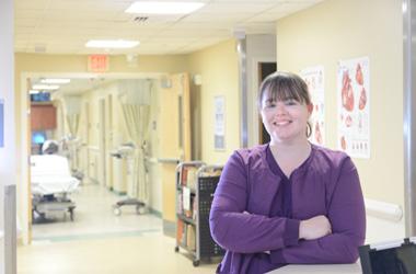Crystal Walker nurse standing in hospital hallway