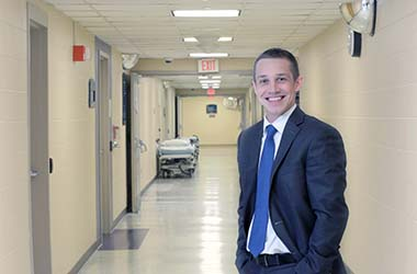 Blog Ryan Wille standing in hospital hallway