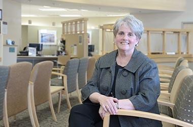 Blog Sue Schwab sitting in Practice waiting room