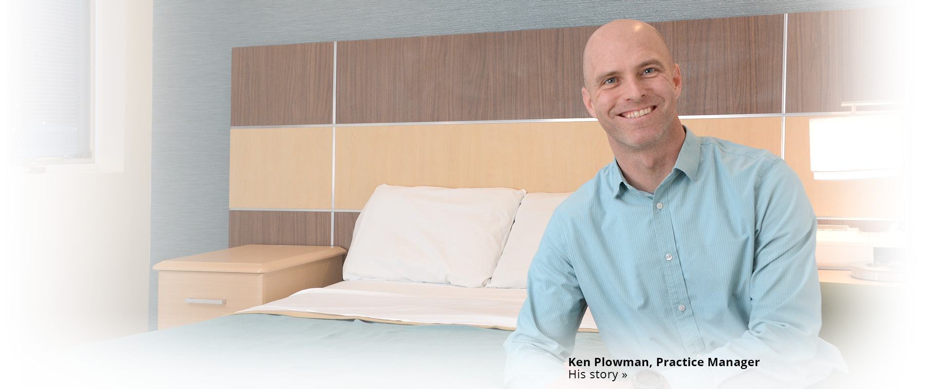 Ken Plowman next to sleep clinic bed