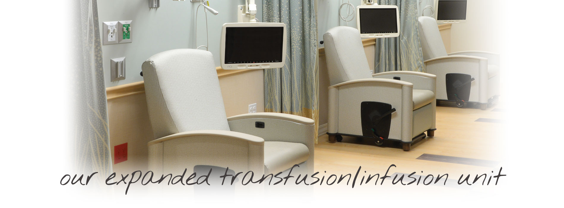 Infusion room with comfortable chairs and medical equipment