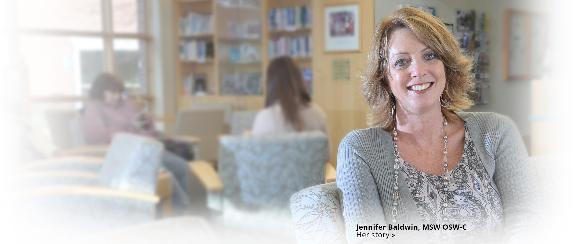 Jennifer Baldwin sitting in an office area